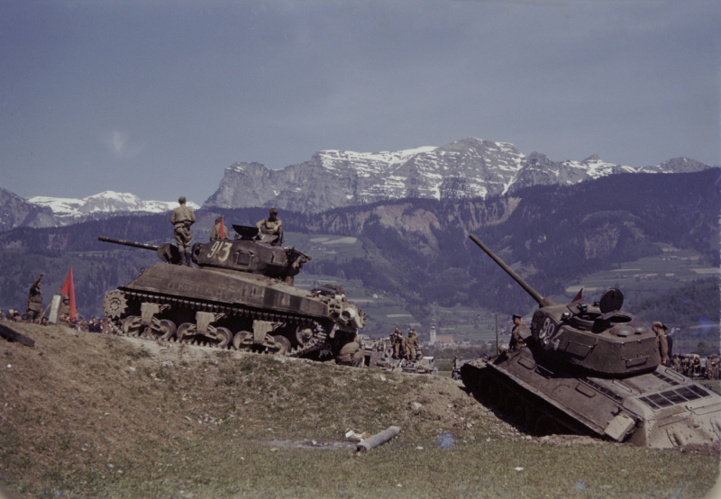 Members of the 9th Armored Division meet up with units of the Red Army near Linz, Austria