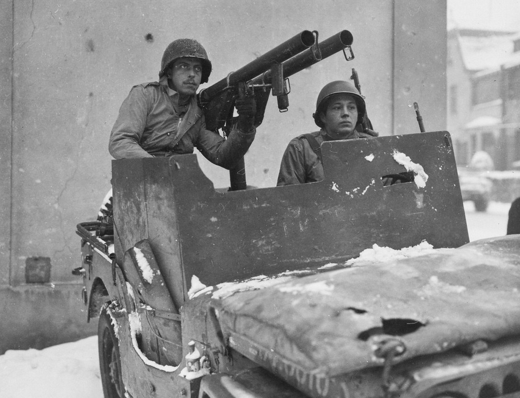 T/5 Louis Gergye managing the 9-ID AT Jeep somewhere in Germany, January 1945
