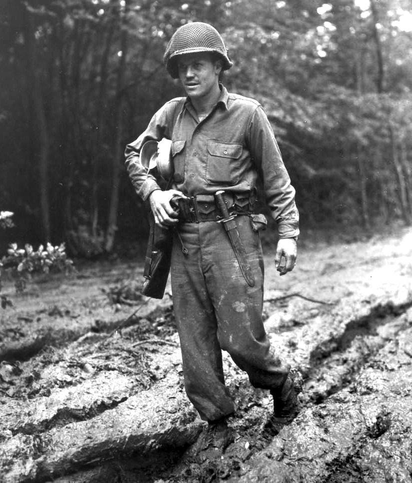 A soldier of the 9th Infantry Division trudges through thick muddy roads. Battle of Hürtgen Forest 1944