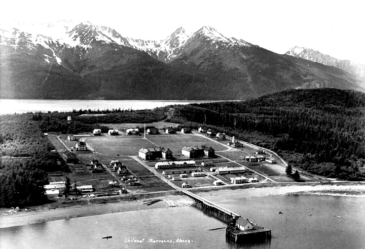 Aerial view focusing in on Fort William H. Seward barracks and parade grounds; river and mountains behind. (Source Alaska Digital Library)