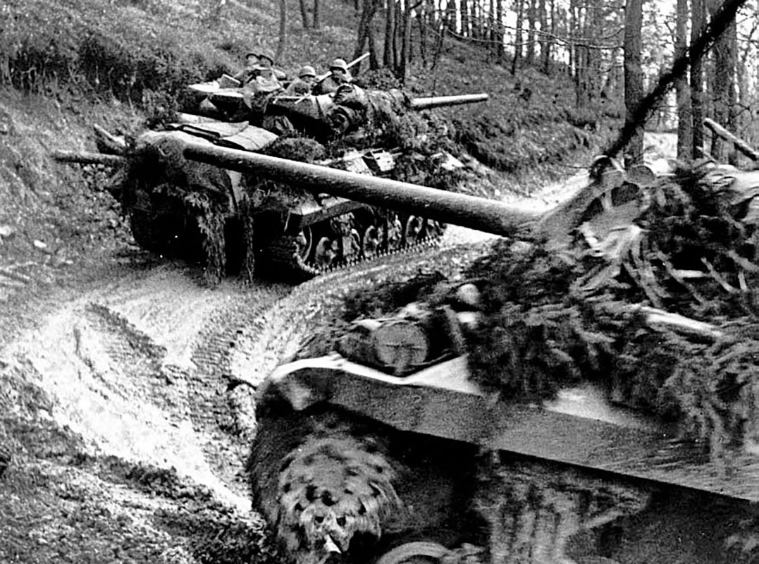 M-10 Tank Destroyers moving on a narrow trail through the Hürtgen Forest. The 3-inch gun provided direct fire support against dug-in German positions. The few roads and trails became ambush zones for the defending Germans