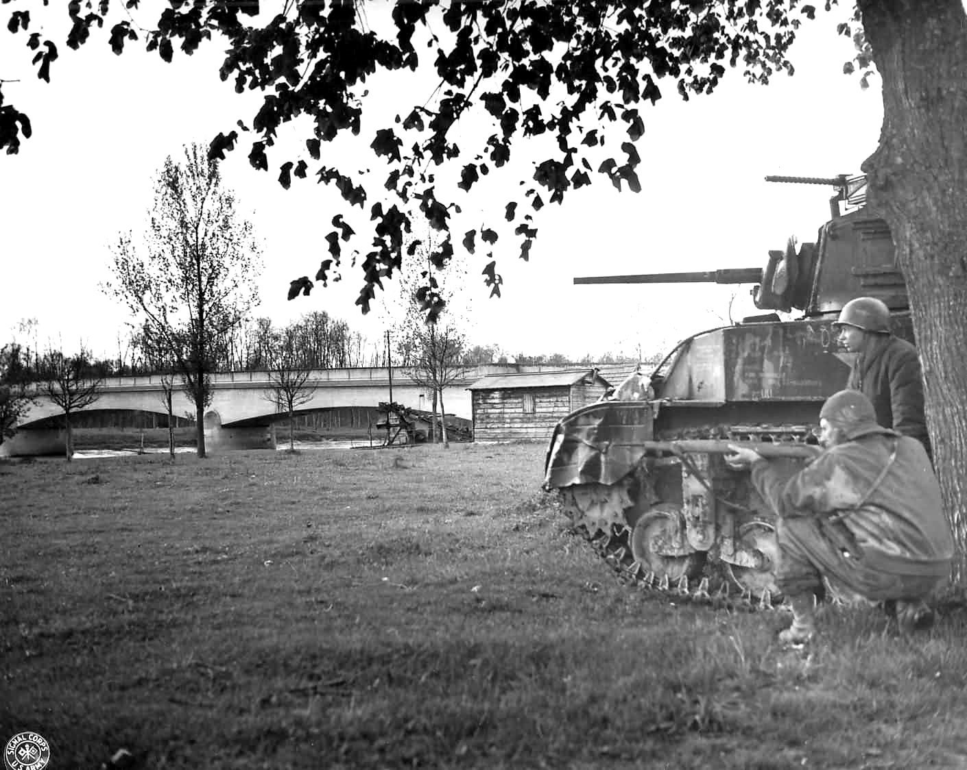 M5A1 Stuart tank and GI with a German K-98 Sniper Rifle (Location Unknown) ETO, 1944