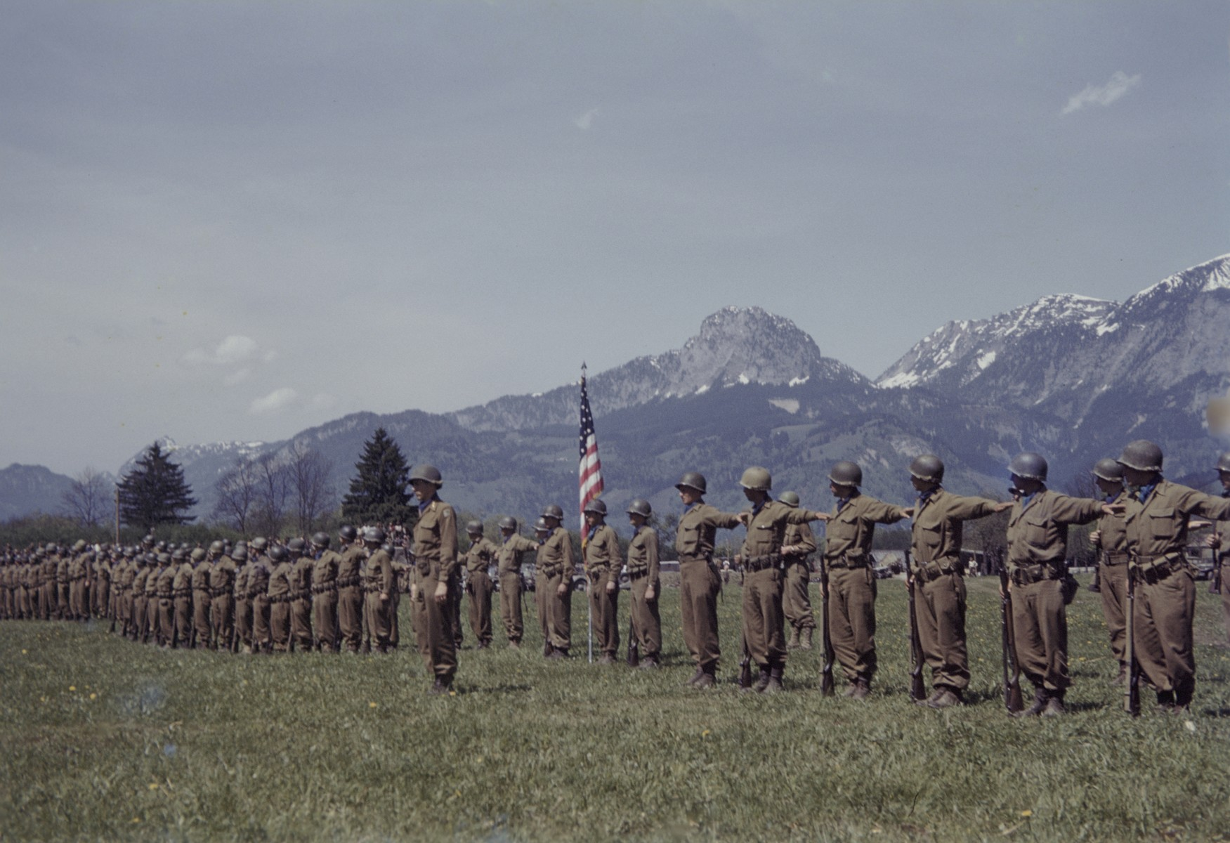 Members of the U.S. 9th Armored Division meet up with units of the Red Army near Linz, Austria