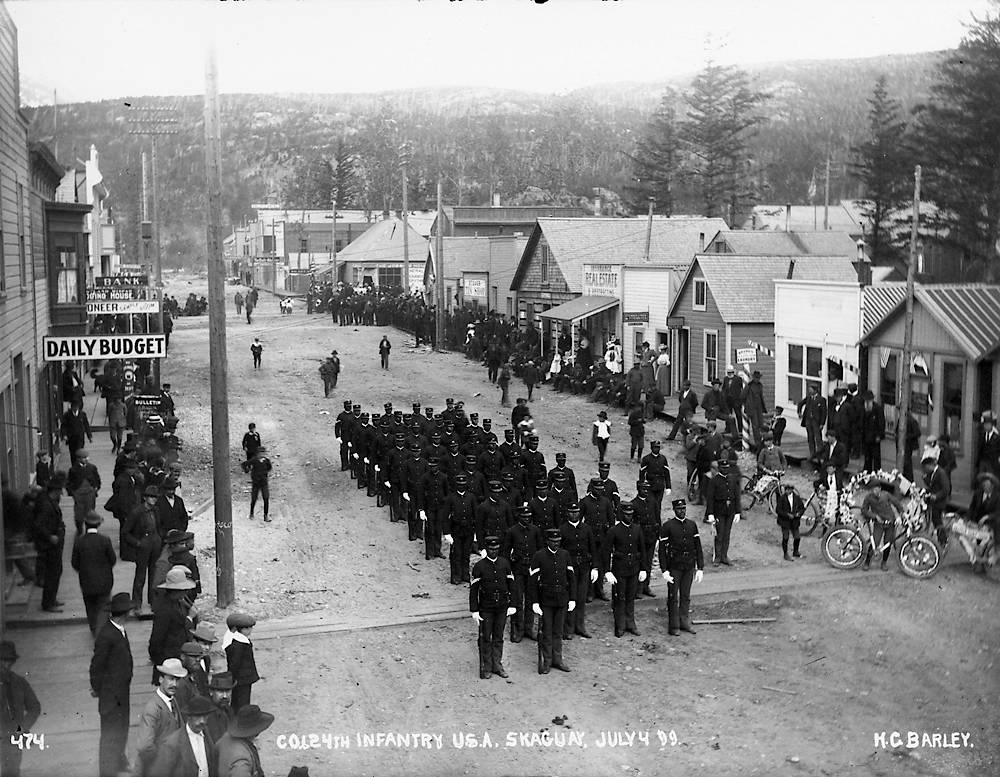 Love Co, 24th Infantry, marches down the '5th Avenue' in Skagway for American Independence Day (Source Yukon News)