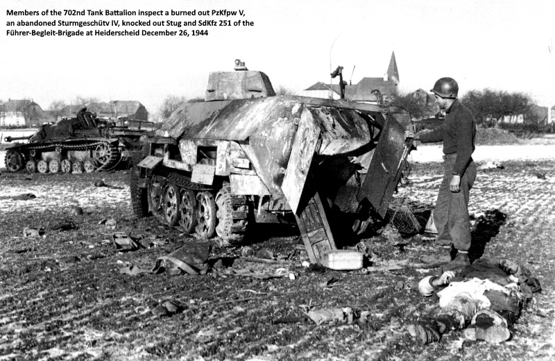 Members of the 702nd Tank Battalion inspect a burned out PzKfpw V, an abandoned Sturmgeschütv IV, knocked out Stug and SdKfz 251 of the Führerbegleitbrigade at Heiderscheid December 26 1944