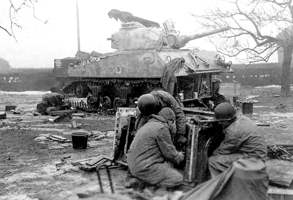 M-4 105-MM Sherman Tank Crew Makes Repairs