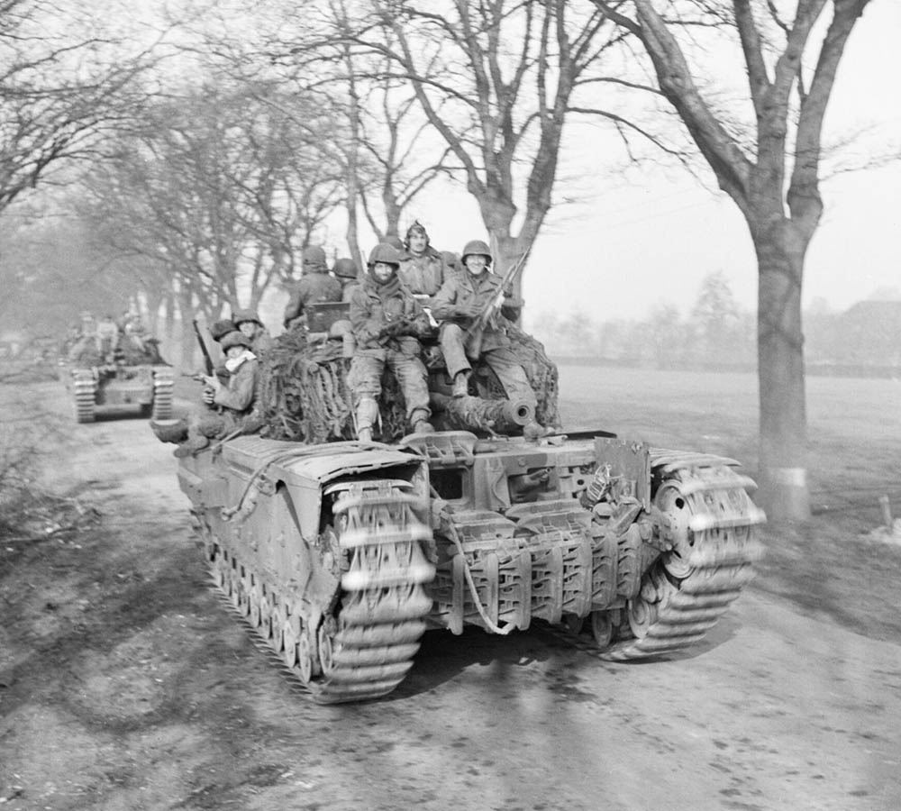 Churchill tanks of 6th Guards Tank Brigade carry US Paratroopers of the 17th Airborne Division.Churchill tanks of 6th Guards Tank Brigade carry US Paratroopers of the 17th Airborne Division