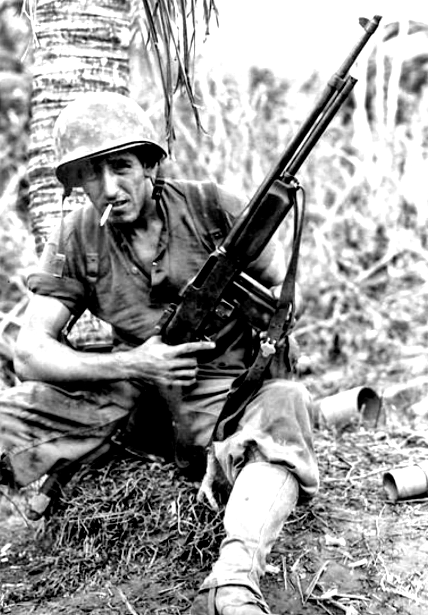 Pfc. Henry J. Latanski of the U.S. 24th Infantry Division is credited with shooting 25 enemy soldiers with his BAR during the Japanese attack of October 21, 1944 on Leyte Island, Philippines