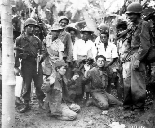 US Army Soldiers 24-ID and Filipino Guerrillas capture two Japanese Soldiers in Mindanao, Philippines Spring 1945