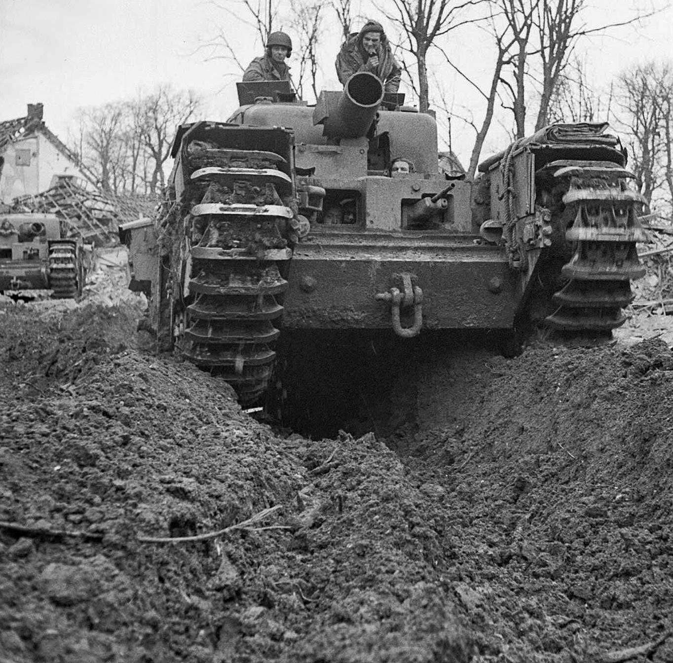1945 - Operation Veritable. A Churchill AVRE with a 290 mm petard mortar, ploughing through mud