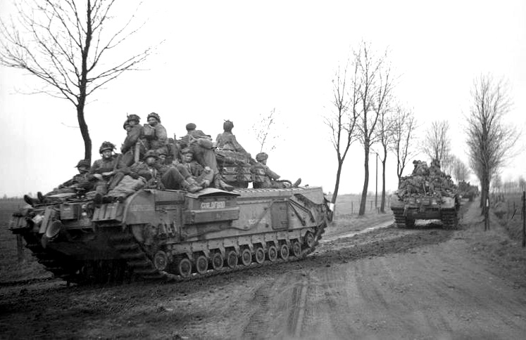 Churchill tanks carrying troops of the British 6th Airborne Division on the advance to Coesfeld, Germany, March 1945