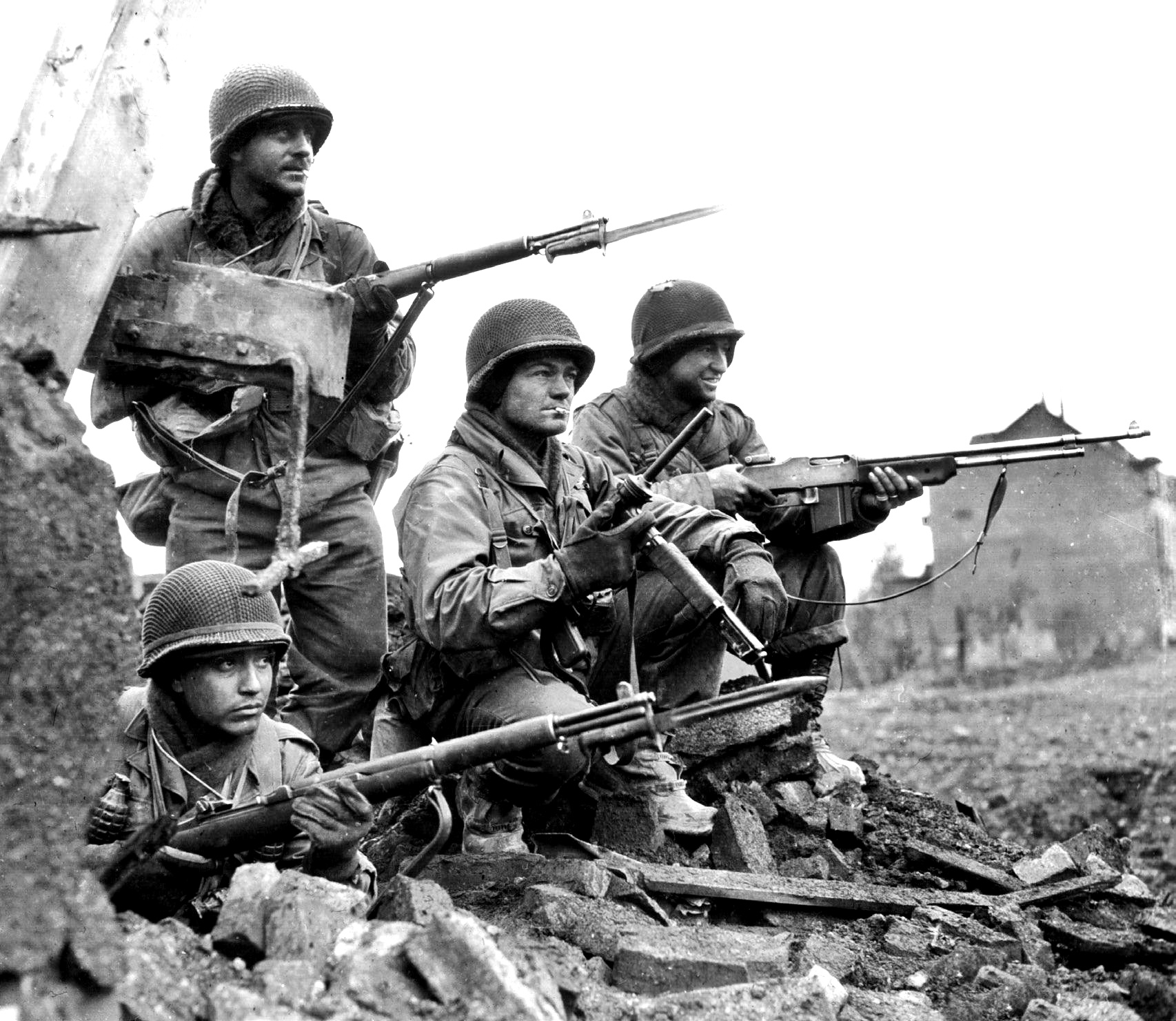 Heavily armed American soldiers during the Battle of The Bulge