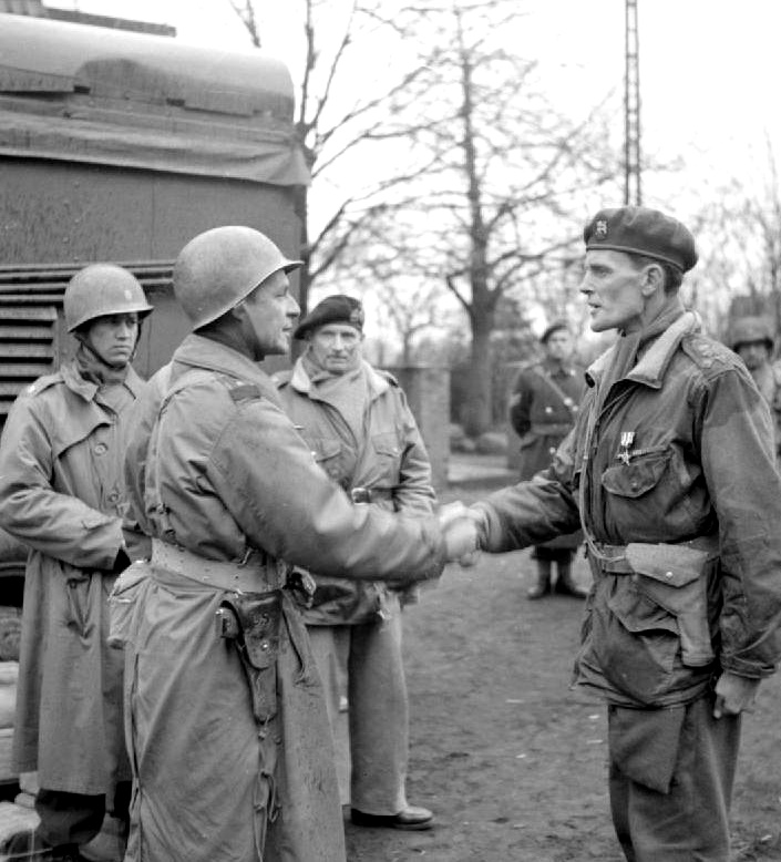 Maj Gen Matthew B. Ridgway (left) CG XVIII Corps (Airborne) decorates Brig James Hill (Canadian Army) with the US Silver Star