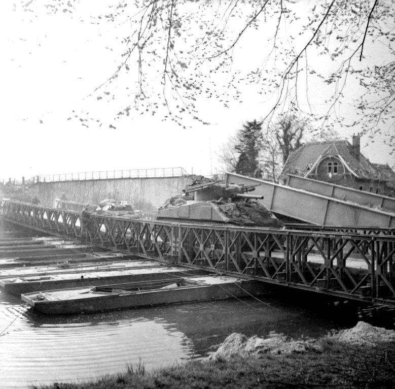 Rocket-armed Sherman tank of the Coldstream Guards crossing the Dortmund-Ems Canal, Apr 1945