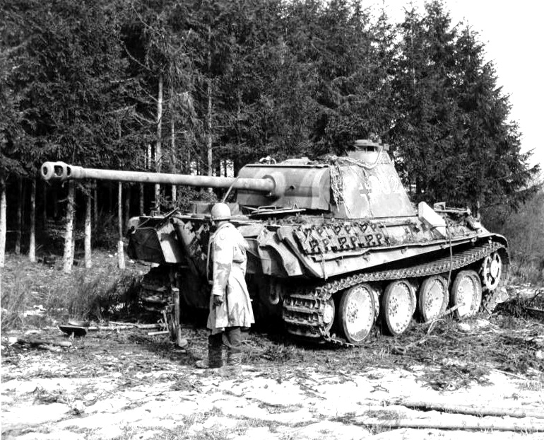 US Army officer standing next an abandoned German Panzer V Panther tank, 1944