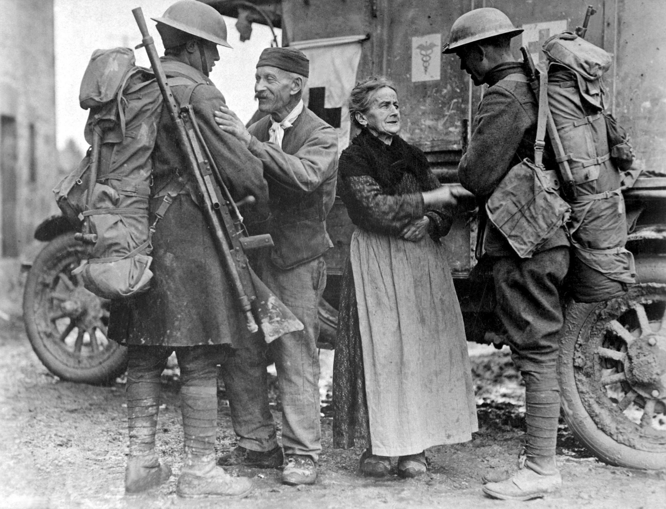 An old French couple, M. and Mme. Baloux of Brieulles-sur-Bar, France, under German occupation for four years, greeting soldiers of the 308th and 166th Infantries upon their arrival during the American advance. Nov 6, 1918.  Lt Adrian C. Duff